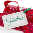 Stock Photo: Red gift box and coupon with germtext