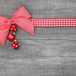 Christmas background with a checked ribbon — Stock Photo