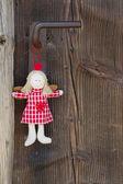 Crown angel hanging on door handle — Stock Photo