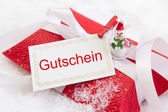 Christmas present box with German text — Stock Photo