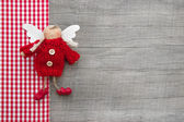 Checkered guardian or christmas angel — Stock Photo