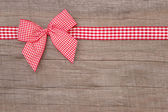 Red checked ribbon decoration — Stok fotoğraf