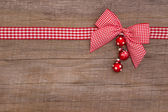 Christmas background with a checked ribbon — Photo