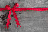 Ribbon decoration on wooden background — Stock Photo