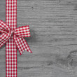 Red and white checked ribbon decoration — Stock Photo #33733403