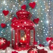 Lantern with candlelights and shnowflakes — Stock Photo