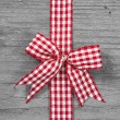 Red and white checked ribbon decoration — Stock Photo