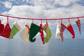 Seascape of hats and socks hanging — Foto Stock