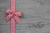 Red and white checked ribbon decoration — Photo