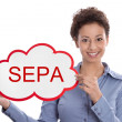 Young woman looking at camera holding a SEPA sign isolated — Stock fotografie #33812919