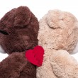 Teddy bears back to back for support — Stock Photo