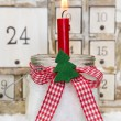 Advent candle with a red checkered bow — Stock Photo
