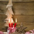 Red burning candles with Christmas decoration — Stock Photo