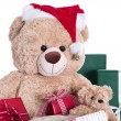 Stock Photo: Teddy bear wearing Christmas hat