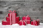 Stack of red Christmas gifts — Stok fotoğraf