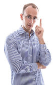 Business man with glasses holding finger up : idea or warning — Stock Photo