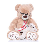 Teddy bear as pediatrician with baby — Stockfoto