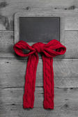 Menu board for message with red bow — Stock Photo