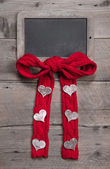 Chalk board for message with knitted bow — Stock Photo