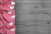 Red and white checkered frame with hearts — Stock Photo