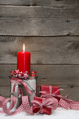Christmas background with candle and a gift box — Stock Photo