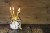 Four golden candles — Stock Photo