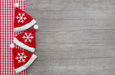 Old wood background with santa hats — Stock Photo
