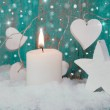 Christmas candle with turquoise hearts — Stock Photo