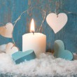 Christmas candle in hearts — Stock Photo