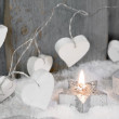 Christmas candle in white with hearts — Stock Photo