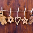 Hanging gingerbread and teddy bear — Stock Photo