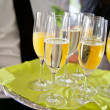 Waiter serving champagne and juice — Stock Photo