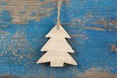 Hanging carved pine tree — Stock Photo