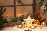 Christmas ornaments on window sill — Stok fotoğraf