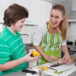 Mother cooking with her son in the kitchen - family life — Stock Photo