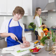 Mother cooking with her son in the kitchen - family life — Stock Photo #34131721