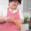 Overweight woman preparing ham - cooking at home  — Stock Photo