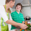 Stock Photo: Mother cooking with her son in kitchen - family life