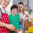 Happy family cooking together — Stock Photo #34136007