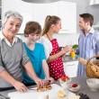 Happy family cooking together - with the grandmother — Stock Photo #34138619