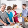 Happy family cooking together - with the grandmother — Stock Photo