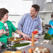 Stock Photo: Father cooking with his children in kitchen - family life