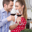 Stock Photo: Loving couple drinking wine in the kitchen