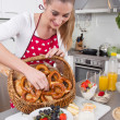 Young woman serving food in the kitchen - making breakfast for t — Stock Photo