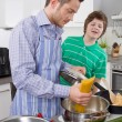 Stock Photo: Father cooking with his son in kitchen - family life