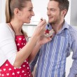 Couple in love cooking together in the kitchen and have fun — Stock Photo