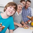 Happy family cooking together — Stock Photo #34142609