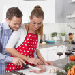 Couple in love cooking together in the kitchen and have fun — 图库照片