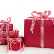 Christmas: stack of red gift boxes with bow and ribbon, isolated — Stock Photo