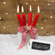 Four red burning christmas candles — Stok fotoğraf